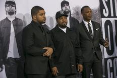 "Cast members Corey Hawkins (R), who portrays Dr. Dre, and O'Shea Jackson Jr. (L), who portrays Ice Cube, pose with producer Ice Cube at the premiere of ""Straight Outta Compton"" in Los Angeles, California August 10, 2015.  REUTERS/Mario Anzuoni"