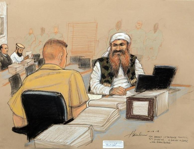Khalid Sheikh Mohammed, (R), the alleged mastermind of the September 11 attacks, speaks with his defense lawyer on the third day of pre-trial hearings in the 9/11 war crimes prosecution as depicted in this Pentagon-approved courtroom sketch at the U.S. Naval Base Guantanamo Bay, Cuba, October 17, 2012. REUTERS/Janet Hamlin