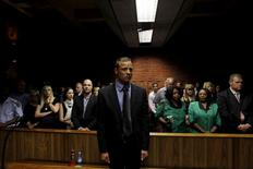 """Blade Runner"" Oscar Pistorius awaits the start of court proceedings in the Pretoria Magistrates court, in this file picture taken February 19, 2013. REUTERS/Siphiwe Sibeko/Files"