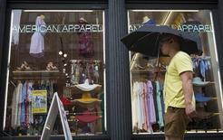 A man walks past an American Apparel store in New York June 19, 2014. . REUTERS/Brendan McDermid