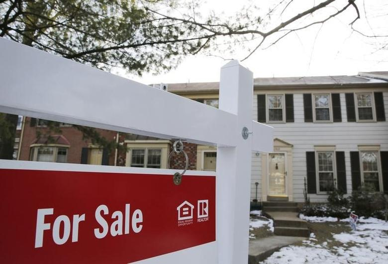 A home for sale sign hangs in front of a house in Oakton, on the day the National Association of Realtors issues its Pending Home Sales for February report, in Virginia in this March 27, 2014 file photo. REUTERS/Larry Downing