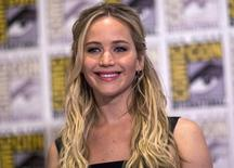 """Cast member Jennifer Lawrence poses at a press line for """"The Hunger Games: Mockingjay - Part 2"""" during the 2015 Comic-Con International Convention in San Diego, California, in this file photo taken July 9, 2015.  REUTERS/Mario Anzuoni/Files"""