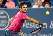 Aug 20, 2015; Cincinnati, OH, USA; Roger Federer (SUI) returns a shot against Kevin Anderson (not pictured) on day six during the Western and Southern Open tennis tournament at Linder Family Tennis Center. Mandatory Credit: Aaron Doster-USA TODAY Sports