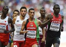 David Lekuta Rudisha of Kenya (R) leads in his heat of the men's 800 metres at the 15th IAAF World Championships at the National Stadium in Beijing, China August 22, 2015.      REUTERS/Dylan Martinez