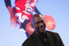 Former basketball great Michael Jordan delivers a speech as he attends a party celebrating the 30th anniversary of the Air Jordan shoe line in Paris, France June 12, 2015.   REUTERS/Gonzalo Fuentes