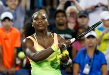 Aug 22, 2015; Cincinnati, OH, USA; Serena Williams (USA) hits tennis balls into the stands after defeating Elina Svitolina (not pictured) in the semifinals during the Western and Southern Open tennis tournament at the Linder Family Tennis Center. Aaron Doster-USA TODAY Sports