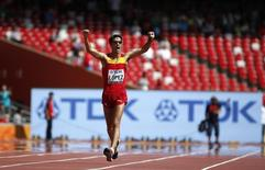Miguel Angel Lopez of Spain celebrates winning the men's 20 km race walk final at the 15th IAAF World Championships at the National Stadium in Beijing, China August 23, 2015.   REUTERS/Lucy Nicholson - RTX1P8Y0