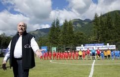 "FIFA President Sepp Blatter arrives for the first game of the so-called ""Sepp Blatter tournament"" in Blatter's home-town Ulrichen, Switzerland, August 22, 2015. REUTERS/Denis Balibouse"
