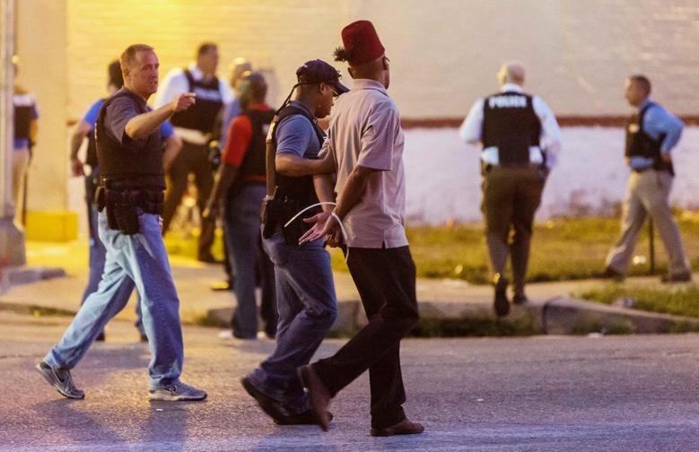 Police arrest a man as protesters gathered after a shooting incident in St. Louis, Missouri August 19, 2015. REUTERS/Kenny Bahr