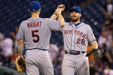 Aug 24, 2015; Philadelphia, PA, USA; New York Mets third baseman David Wright (5) and second baseman Daniel Murphy (28) celebrate a victory against the Philadelphia Phillies at Citizens Bank Park. The Mets won 16-7. Mandatory Credit: Bill Streicher-USA TODAY Sports