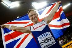 Britain's first placed Greg Rutherford celebrates his victory in the men's long jump final during the 15th IAAF World Championships at the National Stadium in Beijing, China, August 25, 2015.     REUTERS/Kai Pfaffenbach