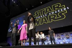 Star Wars: The Force Awakens cast members (L -R) Oscar Isaac, Daisy Ridley, John Boyega, writer, director and producer J.J. Abrams, producer Kathleen Kennedy and show host Anthony Breznican appear at the kick-off event of the Star Wars Celebration convention in Anaheim, California, April 16, 2015.   REUTERS/David McNew