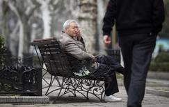 An elderly man sits at a park in Shanghai March 16, 2012.  REUTERS/Carlos Barria
