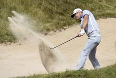 Aug 16, 2015; Sheboygan, WI, USA;  Dustin Johnson plays from a bunker on the 1st hole during the final round of the 2015 PGA Championship golf tournament at Whistling Straits.  Michael Madrid-USA TODAY Sports