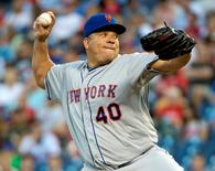 Aug 26, 2015; Philadelphia, PA, USA; New York Mets starting pitcher Bartolo Colon (40) throws a pitch during the first inning against the Philadelphia Phillies at Citizens Bank Park. Eric Hartline-USA TODAY Sports