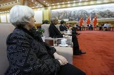 U.S. Federal Reserve Board Chair Janet Yellen (L) and White House Advisor John Podesta (2nd L) attend a meeting with China's President Xi Jinping at the Great Hall of the People in Beijing in this July 10, 2014 file photo.   REUTERS/Jim Bourg