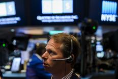 A trader works on the floor of the New York Stock Exchange shortly after the opening bell in New York August 27, 2015. REUTERS/Lucas Jackson