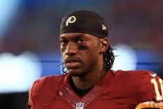 Aug 13, 2015; Cleveland, OH, USA; Washington Redskins quarterback Robert Griffin III (10) on the sidelines during the first quarter of preseason NFL football game against the Cleveland Browns at FirstEnergy Stadium. Mandatory Credit: Andrew Weber-USA TODAY Sports