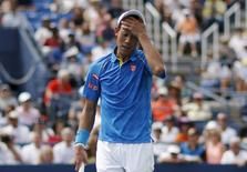 Kei Nishikori of Japan reacts after losing a point to Benoit Paire of France during their match at the U.S. Open Championships tennis tournament in New York, August 31, 2015. REUTERS/Mike Segar  Picture Supplied by Action Images