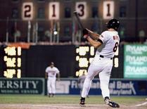 Baltimore Orioles Cal Ripken Jr. hits a base hit in the eighth inning of his record 2,131st consecutive game in Baltimore, Maryland in a September 6, 1995 file photo. REUTERS/Gary Hershorn/Files