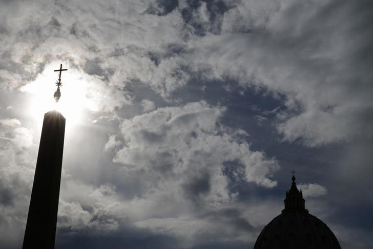 The dome of Saint Peter's Basilica is silhouetted in Saint Peter's Square, at the Vatican March 14, 2013. REUTERS/Christian Hartmann/Files