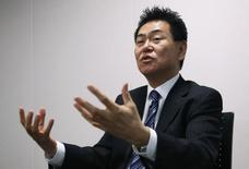 Yasuhisa Arai gestures during an interview with Reuters at the Honda Motor Co's headquarters in Tokyo February 27, 2014.  REUTERS/Yuya Shino