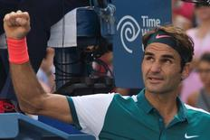 Roger Federer of Switzerland celebrates after defeating Philipp Kohlschreiber of Germany in their third round match at the U.S. Open Championships tennis tournament in New York, September 5, 2015. REUTERS/Adrees Latif   Picture Supplied by Action Images