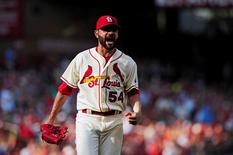 St. Louis Cardinals starting pitcher Jaime Garcia (54) celebrates getting Pittsburgh Pirates second baseman Josh Harrison (not pictured) to ground into a force out to end the seventh inning at Busch Stadium.  Jeff Curry-USA TODAY Sports