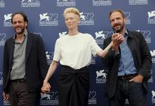 "Director Luca Guadagnino (L), actress Tilda Swinton and actor Ralph Fiennes (R) attend the photocall for the movie ""A Bigger Splash"" at the 72nd Venice Film Festival, northern Italy September 6, 2015. REUTERS/Manuel Silvestri"