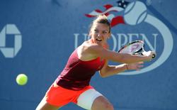 Sep 7, 2015; New York, NY, USA; Simona Halep of Romania returns a shot to Sabine Lisicki of Germany on day eight of the 2015 U.S. Open tennis tournament at USTA Billie Jean King National Tennis Center. Mandatory Credit: Jerry Lai-USA TODAY Sports