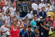 Roberta Vinci of Italy is sorrounded by cameras as she celebrates after defeating Kristina Mladenovic of France in their quarterfinals match at the U.S. Open Championships tennis tournament in New York, September 8, 2015. REUTERS/Adrees Latif   Picture Supplied by Action Images