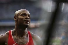 Asafa Powell of Jamaica celebrates after he win the men's 100 metres at during the IAAF Diamond League athletics meeting at the Stade de France Stadium in Saint-Denis, near Paris, France, July 4, 2015.  REUTERS/Stephane Mahe