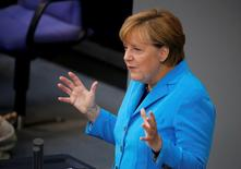 German Chancellor Angela Merkel gestures as she addresses the lower house of parliament Bundestag on Germany's 2016 budget in Berlin, Germany September 9, 2015. REUTERS/Fabrizio Bensch