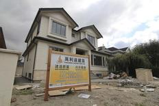 A contractor's sign stands outside a mansion currently under construction in a Vancouver neighbourhood popular with Chinese buyers September 9, 2014. REUTERS/Julie Gordon