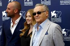 "Director Jerzy Skolimowski (R) stands with cast members Paulina Chapko (C) and Wojciech Mecwaldowski as they attend the photocall for the movie ""11 Minut"" (11 Minutes) at the 72nd Venice Film Festival, northern Italy September 9, 2015. REUTERS/Stefano Rellandini"