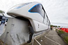 A man looks underneath an Innovia Monorail 300 train by Bombardier Transportation at the InnoTrans railway technology trade fair in Berlin, in this September 25, 2014 file photo. REUTERS/Thomas Peter/Files