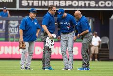 Sep 12, 2015; Bronx, NY, USA; Toronto Blue Jays shortstop Troy Tulowitzki is assisted by the Toronto trainer after colliding with center fielder Kevin Pillar (not pictured) during the second inning of the game against the New York Yankees during the first game of a doubleheader at Yankee Stadium.  Gregory J. Fisher-USA TODAY Sports