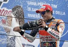Honda MotoGP rider Marc Marquez of Spain celebrates on podium after winning the San Marino Grand Prix in Misano Adriatico circuit in central Italy September 13, 2015.   REUTERS/Max Rossi