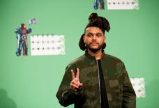 The Weeknd poses backstage during the 2015 MTV Video Music Awards in Los Angeles, California, August 30, 2015.  REUTERS/Danny Moloshok