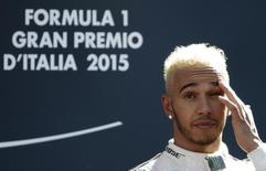 Mercedes Formula One driver Lewis Hamilton of Britain gestures as he celebrates his victory in the Italian F1 Grand Prix in Monza, northern Italy September 6, 2015. REUTERS/Max Rossi