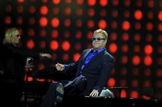 British singer-songwriter Elton John performs with his band during a concert in Gijon, July 17, 2015. REUTERS/Eloy Alonso