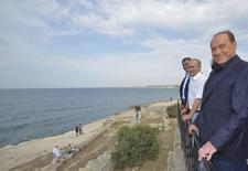 Russian President Vladimir Putin (2nd R) and Italian former Prime Minister Silvio Berlusconi (R) visit Chersonesus Tavrichesky (Tauric Chersonesos) National Reserve in the Black Sea port of Sevastopol, Crimea, September 12, 2015. Berlusconi became the most prominent Western politician to visit Russian-annexed Crimea when he strolled beside the Black Sea on September 11 with Putin. REUTERS/Alexei Druzhinin/RIA Novosti/Kremlin ATTENTION EDITORS - THIS IMAGE HAS BEEN SUPPLIED BY A THIRD PARTY. IT IS DISTRIBUTED, EXACTLY AS RECEIVED BY REUTERS, AS A SERVICE TO CLIENTS.        TPX IMAGES OF THE DAY