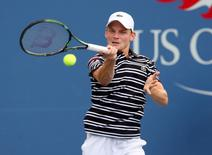 David Goffin of Belgium returns a shot to Roberto Bautista Agut of Spain on day five of the 2015 U.S. Open tennis tournament at USTA Billie Jean King National Tennis Center. Mandatory Credit: Jerry Lai-USA TODAY Sports  / Reuters