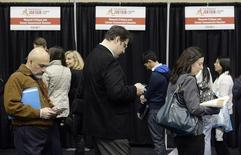 People wait in line for resume critique and career assessment sessions at the 2014 Spring National Job Fair and Training Expo in Toronto, April 3, 2014. REUTERS/Aaron Harris