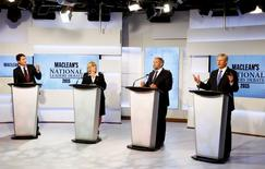 Liberal leader Justin Trudeau (L), Green Party leader Elizabeth May (2nd L) and New Democratic Party leader Thomas Mulcair listen as Conservative Leader Stephen Harper (R) speaks during the first leaders' debate in Toronto August 6, 2015 . REUTERS/Mark Blinch