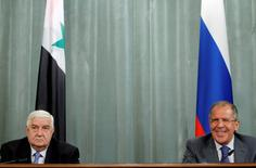 Russian Foreign Minister Sergei Lavrov (R) and Syrian Foreign Minister Walid al-Moualem listen during a joint news conference in Moscow April 10, 2012. Moualem said on Tuesday that Damascus wanted guarantees from international peace envoy Kofi Annan that armed groups attacking its troops would commit to a ceasefire under a U.N.-backed peace plan.  REUTERS/Denis Sinyakov (RUSSIA - Tags: POLITICS CIVIL UNREST PROFILE) - RTR30JS6