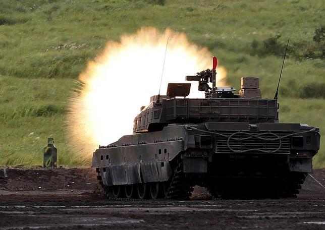 9月19日、成立した安全保障の関連法制によって、自衛隊の任務は拡大する。写真は陸自戦車。御殿場の東富士演習場で8月撮影(2015年 ロイター/Yuya Shino)