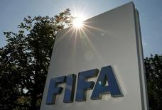 The logo of FIFA is seen in front of its headquarters in Zurich, Switzerland July 20, 2015. REUTERS/Arnd Wiegmann/Files