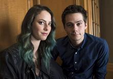 "Cast members Kaya Scodelario (L) and Dylan O'Brien from the film ""Maze Runner: The Scorch Trials"", pose for pictures in Beverly Hills, California August 28, 2015. REUTERS/Phil McCarten"