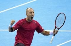 Belgium's Steve Darcis reacts during his semi-final match of the Davis Cup against Argentina's Federico Delbonis at Forest National arena in Brussels, Belgium September 20, 2015.  REUTERS/Yves Herman